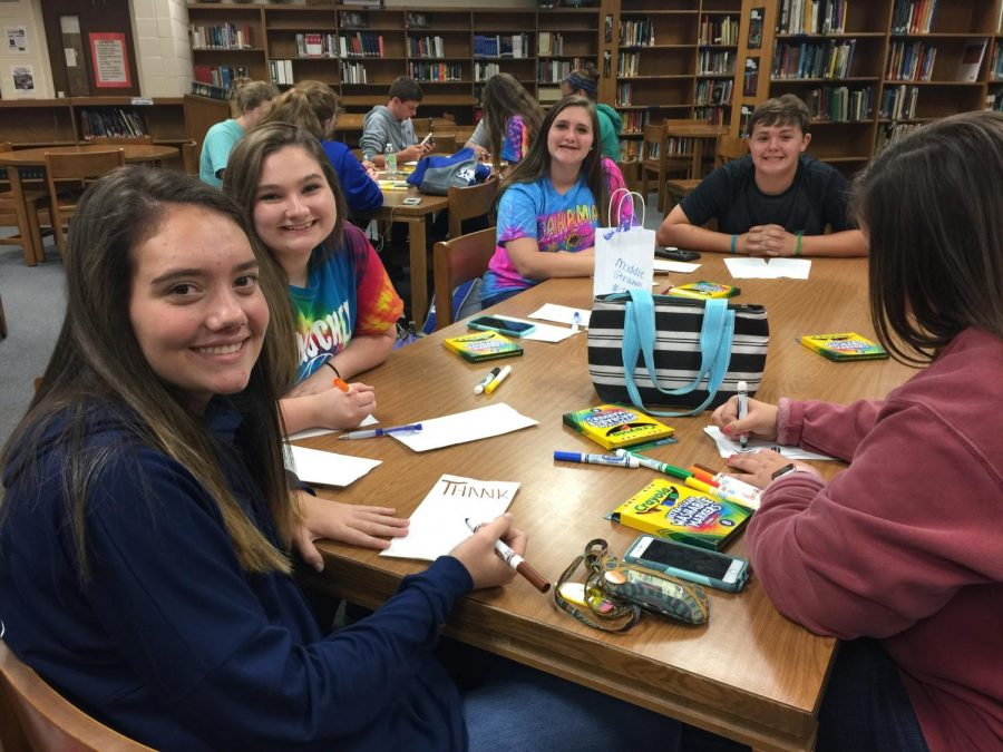 """In the picture you have sophomores, Allison Jackson, Emma Hyde, Chloe Cook, Zach Smith, and Audrey Young. This group is participating in decorating bags for Key Club. The bags will be given to our support staff. Young said, """"I appreciate all of our support staff for all that they do for our school, and the students in it. It felt really good doing something nice for them."""""""