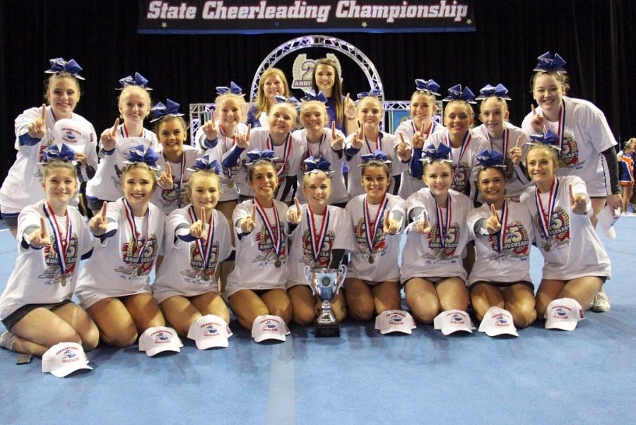 The group of 20 girls got together for a picture under the state cheerleading championship sign smiling big and holding up a number one after winning the 2017 AA state championship. The girls received a hat, medal, t-shirt, and trophy after winning.