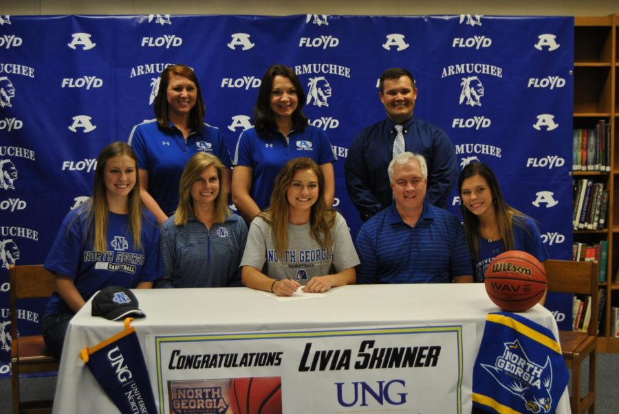 Livia+Skinner+signed+with+the+University+of+North+Georgia+on+Friday%2C+April+27th.+She+will+play+basketball+for+UNG.+Back+row+from+left+to+right%3A+Coaches+Hanna+Everett+and+Michelle+Arp%2C+and+Principal+Mr.+Rhodarmer.+Front+row+from+left+to+right%3A+Mary+Bess+Skinner%2C+Patrice+Skinner%2C+Livia+Skinner%2C+Scott+Skinner%2C+and+Melissa+Skinner.+
