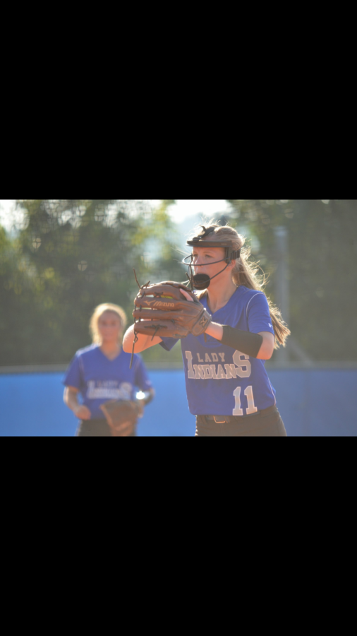 Senior+Harlie+Lewis+begins+her+pitch+after+she+gets+the+pitch+from+head+Coach+Shane+Arp+against+Model.