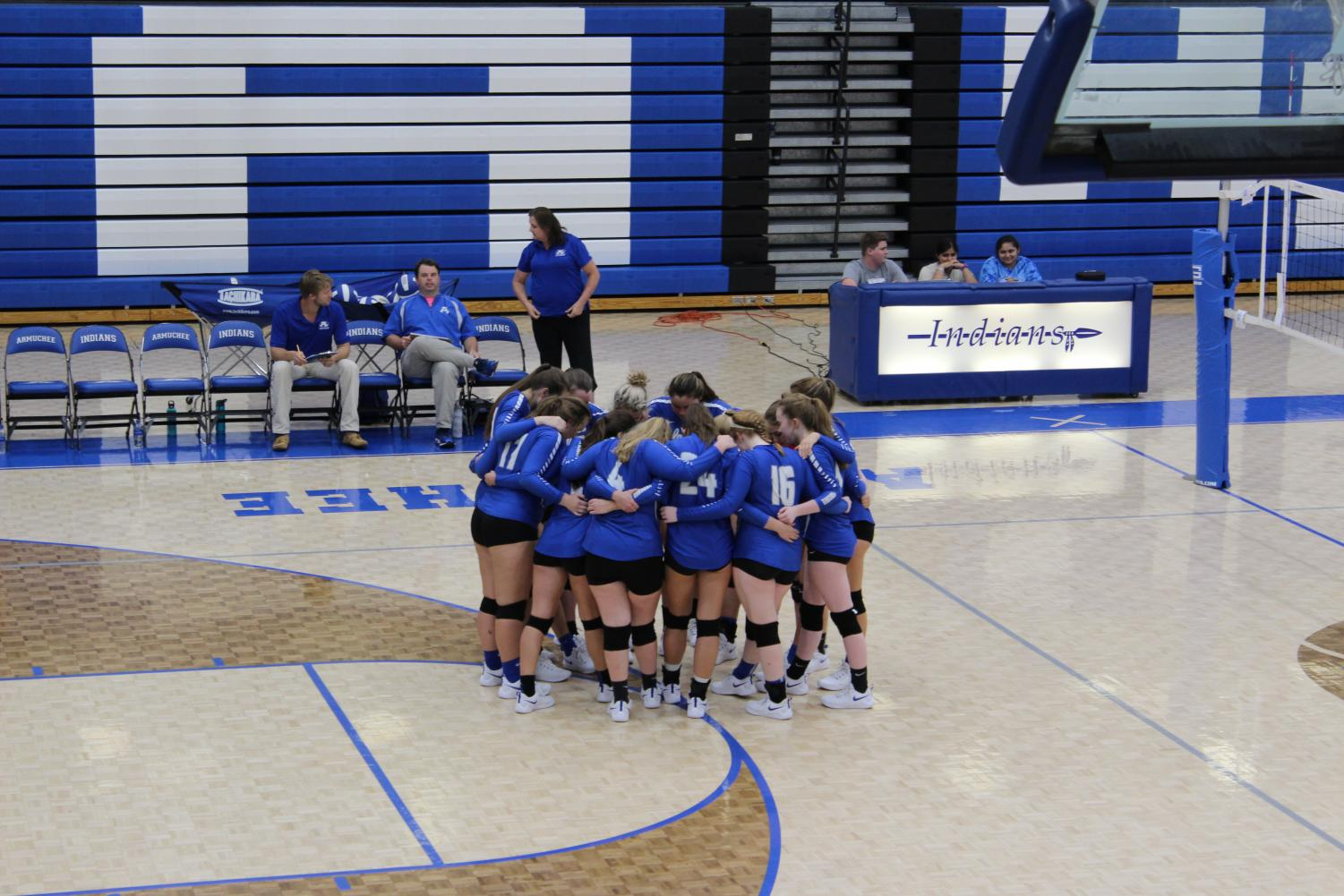 The Armuchee volleyball team huddles and thinks of a strategy for beating the Rockmart.