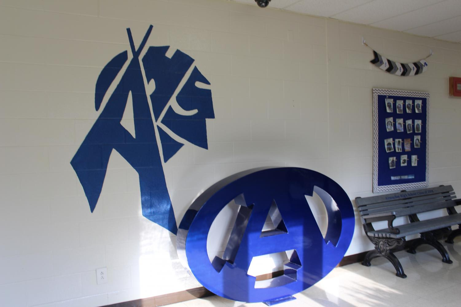 Outside the office sits the 2018 class bench, but that isn't the only new thing in that spot. Painted on the wall is an A in the shape of a teepee and an Indian head. Next to it sits a decoration of the Armuchee A logo.