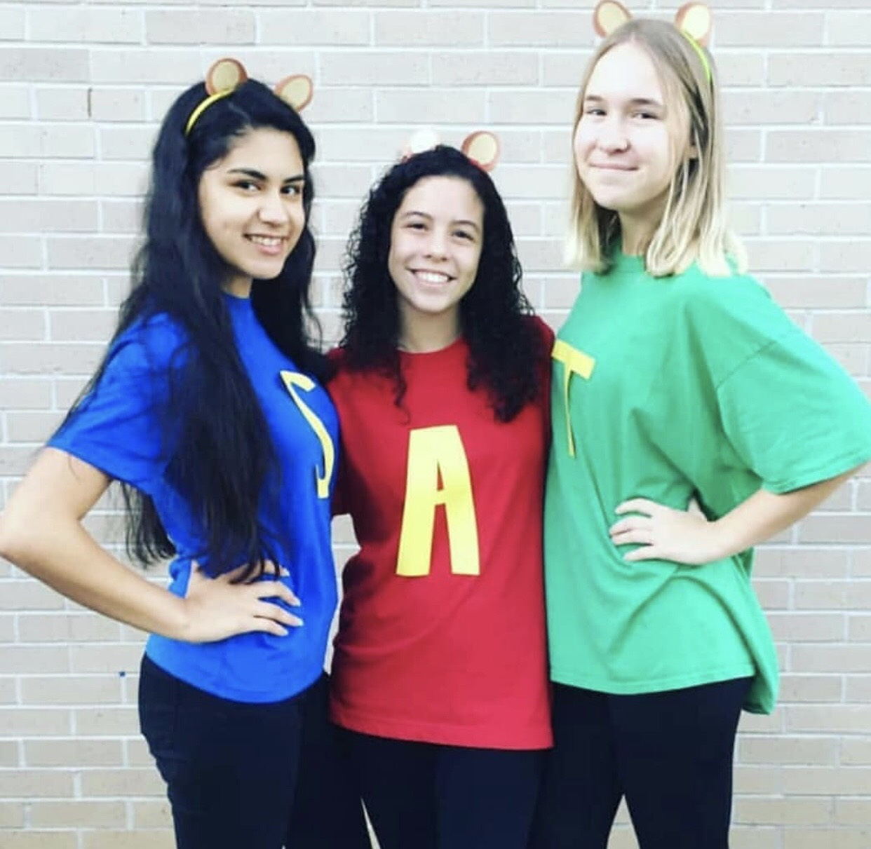 Left to right: Donna Cornejo, junior, Ana Reyes, junior, and Kassi Daniels, junior, dressed as Alvin and the Chipmunks on TV Tuesday.