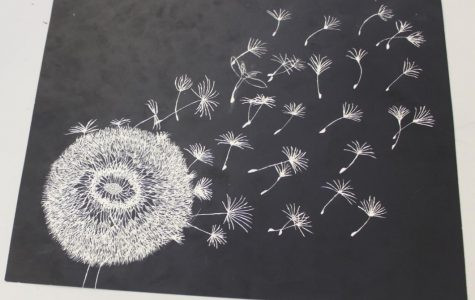 Sophomore Logan Lively's scratchboard is a dandelion blowing in the wind. Her inspiration comes from the dandelions in the field at her grandparents' house when she was young. It represents growing up.