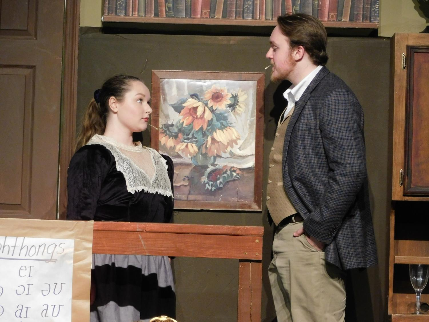 Shiloh St. Clair, junior writes, does drama, piano, and vocal lessons as hobbies. She was recently in a play called My Fair Lady. In this picture, she is acting out one of the scenes with a fellow actor.
