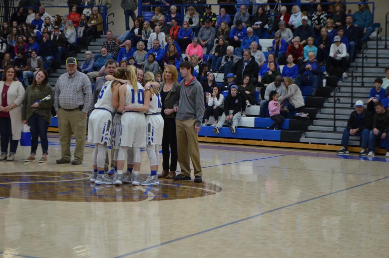 Senior%2C+Madison+Smith+hugs+Juniors%2C+Grace+Stanley%2C+Katie+Shinholster+and+Sophomore+Chloe+Purdy.