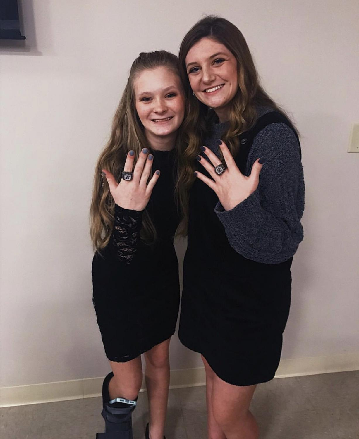 Annie Conley, freshman, and Logan Lively, sophomore, show off their bling they received on February 7, 2019. Lively said,