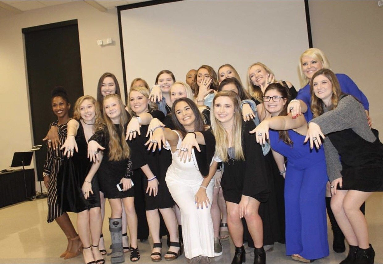 The+Competition+Cheerleading+team+takes+a+group+picture+after+recieving+their+back+to+back+State+Champion+rings.+Freshman%2C+Paige+Wilkins+was+%22in+awe%22+when+she+recieved+her+ring.+She+said%2C+%22They+were+so+perfect.+I+was+proud+because+it+showed+all+of+mine+and+my+teammates+hard+work+and+what+we+accomplished.%22+