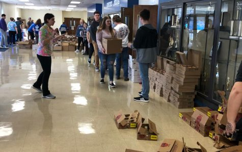 At the pop up market held on Wednesday, March 13th many NHS and Key Club members volunteered their time to help the people in need. Students helped stuff the boxes then helped the people carrying them to the cars.