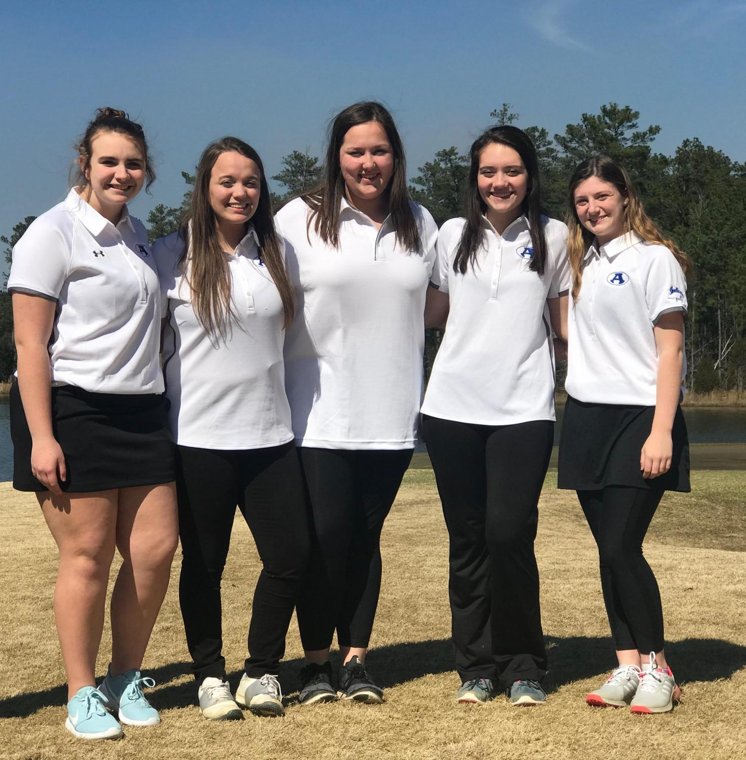 The+girls+golf+team+poses+for+a+picture+before+their+golf+match+against+Rockmart.+Left+to+right%3A+Katie+Leonard%2C+freshman%2C+Gracie+Williams%2C+Audrey+Young%2C+Allison+Jackson%2C+juniors%2C+and+Logan+Lively%2C+sophomore.+