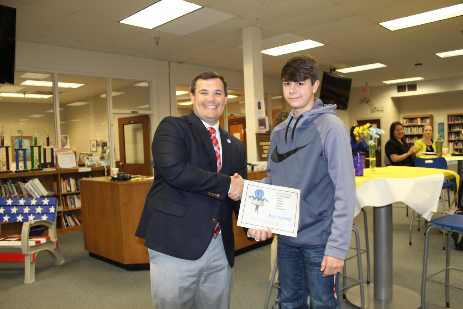 Mr. Rhodarmer handing certificate to Wyatt Hightower