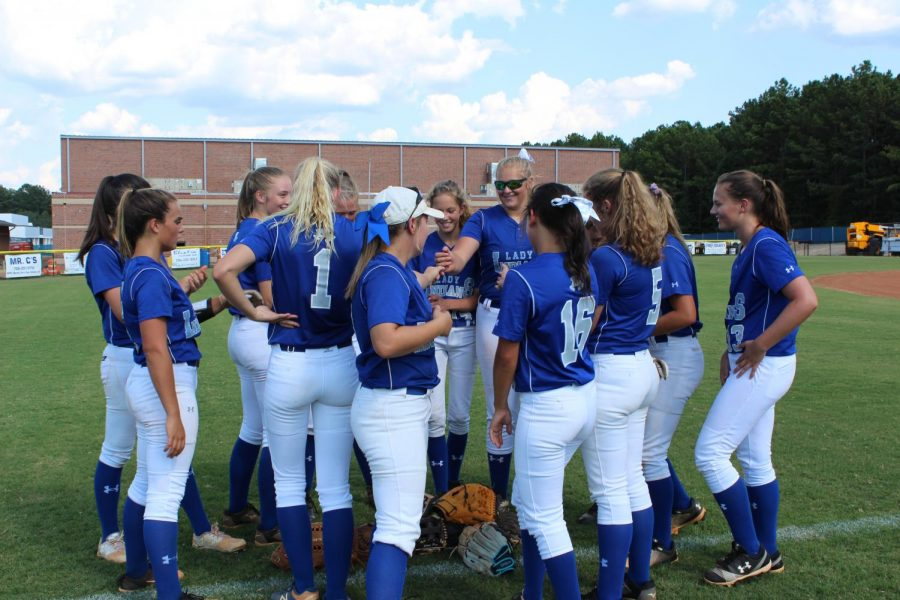 Softball+team+getting+ready+to+play+against+Coosa