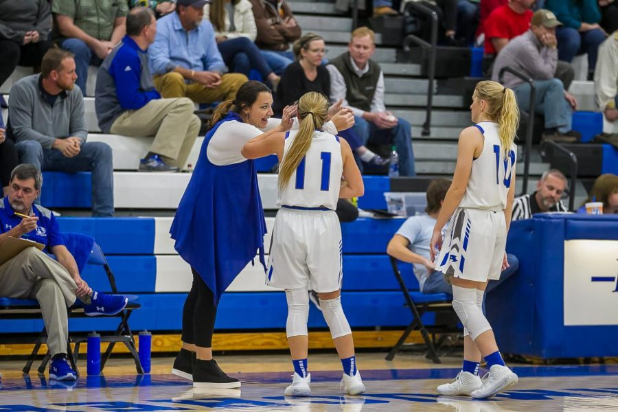 Coach Michelle Arp speaks to junior, Julia Williams, and Senior Katie Shinholster. Photo Courtesy: J and S Photography